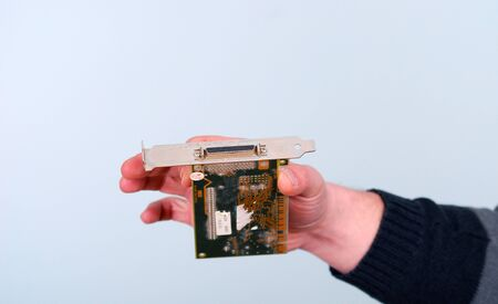 semi conductor: Picture of a male hand hold computer card