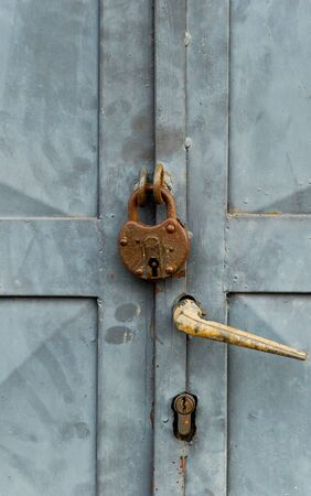 Picture of an Old vintage lock on a metal door photo