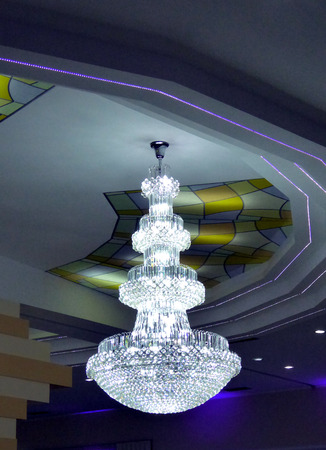 picture of a beautiful crystal chandelier in wedding hall photo