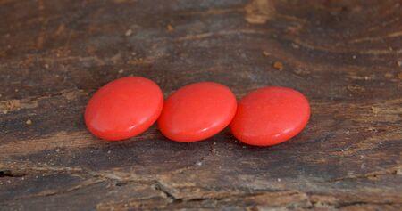vitamin pill: picture of a Red vitamin pill