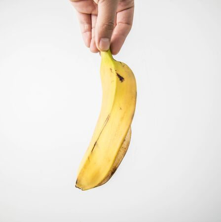 bannana: Picture of a Hand hold peeled banana