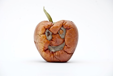 Picture of a Rotten apple , human face, aging concept