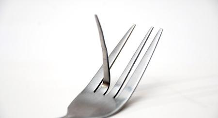 desprecio: Imagen de un tenedor a la mierda Foto de archivo