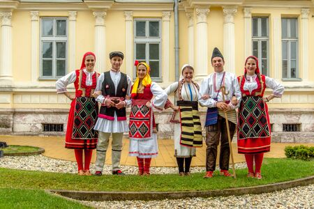 is well known: Members of folk group Tashe Miloshevski , posing in yard of a well known building Saray in Macedonia.Resen , Macedonia on november 25, 2013