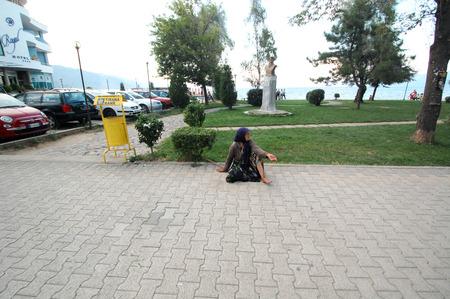 penury: POGRADEC, ALBANIA - AUGUST 07 : An unidentified homeless woman begging on  street on August 07, 2015 in Pogradec, Albania