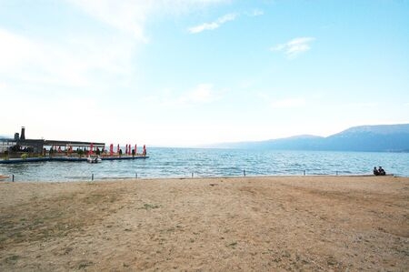lake dwelling: City of Pogradec on albanian part of a lake Ohrid, which is divided by Albania and Macedonia. Pogradec, Albania Stock Photo