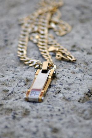 golde: golde necklace on cement
