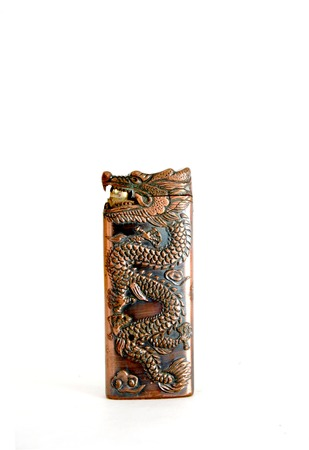 cigarette lighter: picture of a dragon  like cigarette lighter on a white background Stock Photo