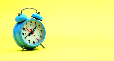 transience: Picture of blue alarm clock on a yellow background