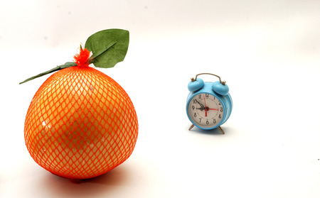 turns of the year: It is time for diet. Blue alram clock and food Stock Photo