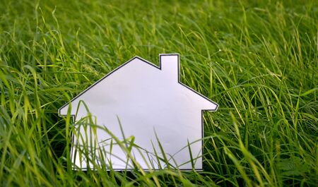 sweet grass: picture of a coloring book house on a green grass