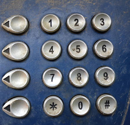 payphone: Picture of a Close up of a dirty and dusty  payphone keypad