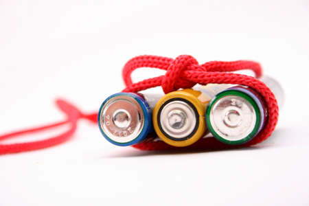 bound: Battery bound with red  rope. Energy concept