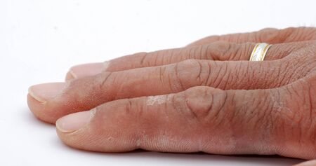 handcarves: picture of a worker hand with wedding ring Stock Photo
