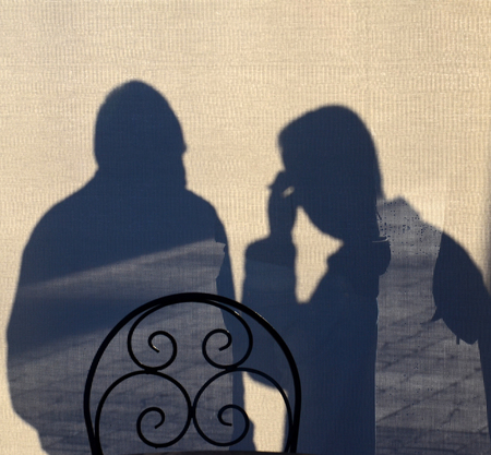 people shadow: Picture of a Silhouette of a Men in discussion Stock Photo