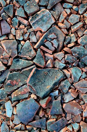red stone: picture of a broken ceramic roof tiles Stock Photo