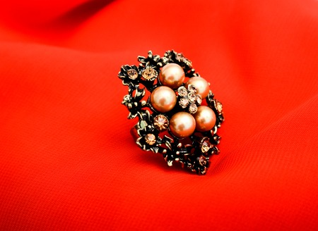 bijoux: picture of a Fashion ring. Red background,