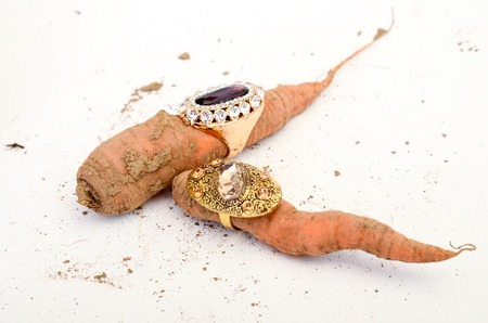 picture of a Fashion ring on a raw carrot Stock Photo