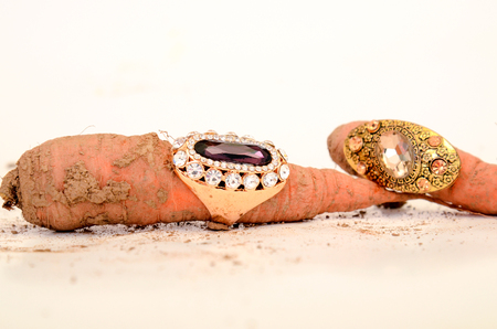 bijoux: picture of a Fashion ring on a raw carrot Stock Photo