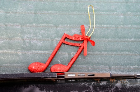 wiper: Picture of a Christmas decor on a  car wiper with frost