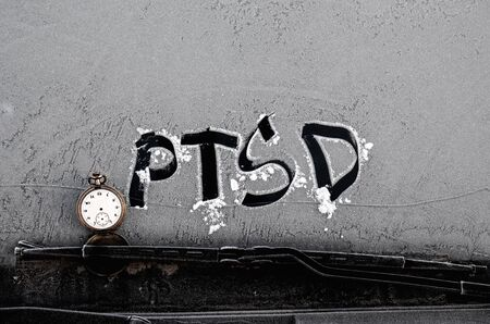 sanatorium: Picture of a PTSD words on frost background
