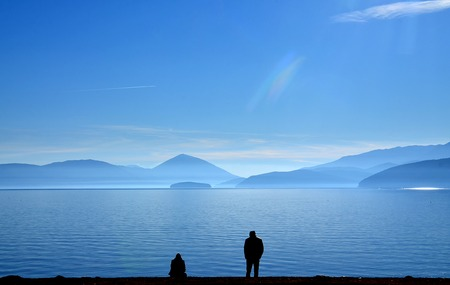 relationship difficulties: Picture of a couple having relationship difficulties,lake prespa, macedonia