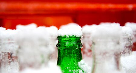 beer bottle: Picture of a Snow on an open drinking bottle Stock Photo