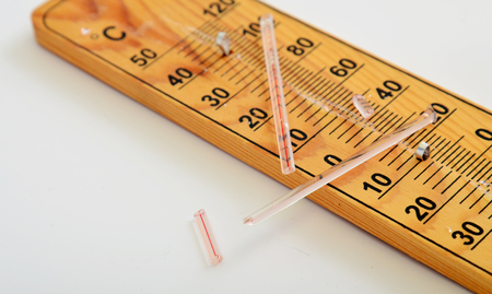 hotter: Picture of a Wooden Out of Order  Thermometer Stock Photo