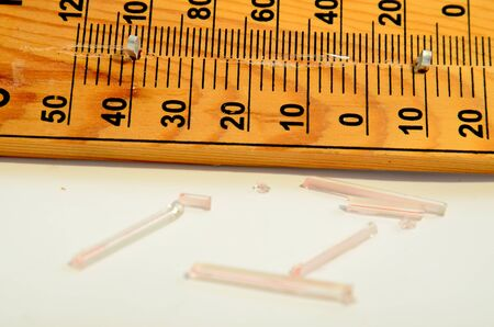 extreme science: Picture of a Wooden Out of Order  Thermometer Stock Photo
