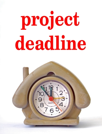 project deadline: Picture of a Cute house shape alarm clock with phrase project deadline Stock Photo