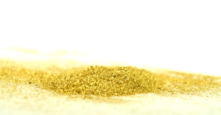 Picture of a Sparkling Gold Color Powder on White