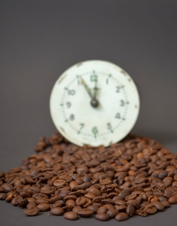 dark face: Picture of a Roasted cofee and  vintage clock