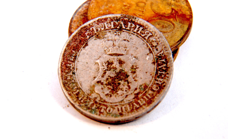 numismatist: Picture of a Vintage old rusty coin