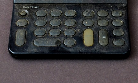 multiplying: Picture of an Old dusty and dirty calculator Stock Photo
