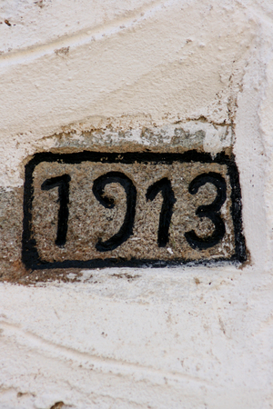 nine years old: picture of a 1913 year number on a wall