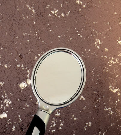 miror: picture of a Cheap plastic round hand mirror Stock Photo