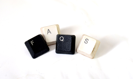 faqs: Picture of  Faqs text  with dirty keyboard buttons