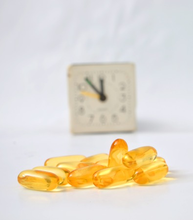 omega 3: Picture, Omega 3 pills in a fron of alarm clock