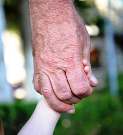 nephew: Picture of a Grandpa hold baby hand Stock Photo