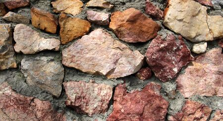 rockwall: Texture of a stone wall with cement Stock Photo