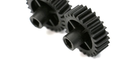 asterix: picture of a black old plastic dirty cogwheel