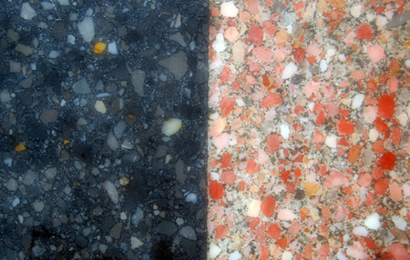 table surface: picture of a black and  orange stone table   surface Stock Photo