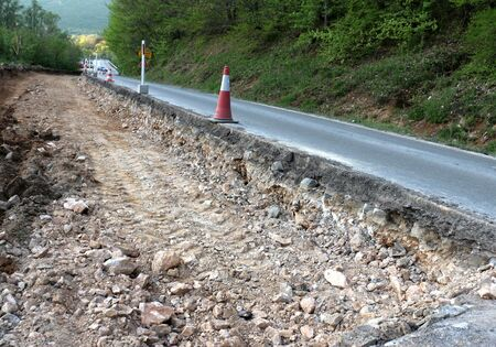 flashers: picture of an apshalt  road in repair