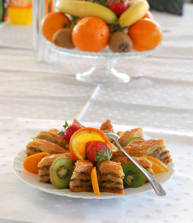 turkiye: picture of a sweet turkish baklava and fresh fruits in a  plate