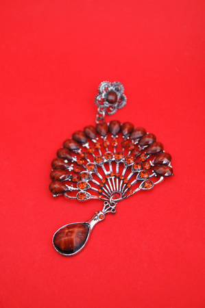 brooch: picture of gem brooch on a red background Stock Photo