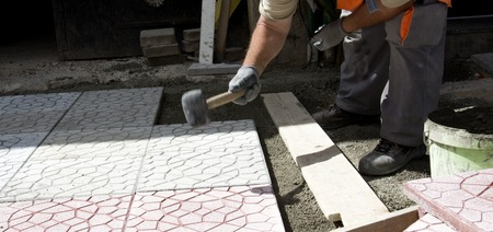 municipal: Pictureof a Municipal construction workers paving Stock Photo