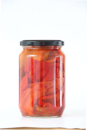 conserved: Isolated glass jar with conserved roasted red paprika