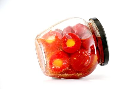 conserved: Isolated glass jar with conserved roasted stuffed red paprika Stock Photo