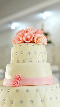 Picture of a white wedding cake and pink flowers on top stock photo picture of a white wedding cake and pink flowers on top stock photo 59922340 mightylinksfo