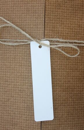 despatch: Parcel tied with string with white address label attached Stock Photo